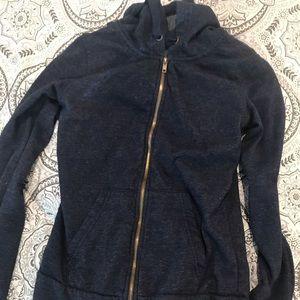 Blue zip up jacket.